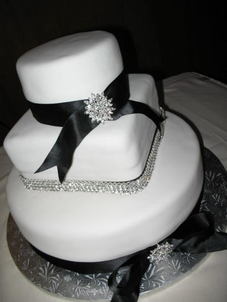 This cake was decorated with rhinestones and ribbon to match the wedding colors.
