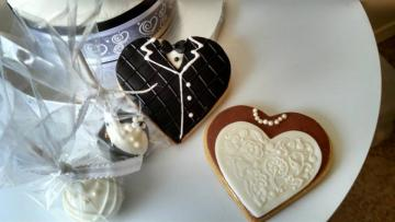 Beautifully decorated wedding cookies.